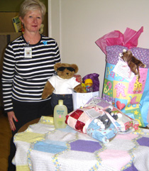 Donna Desmaris, Outreach Coordinator, with some gifts given to babies born through Goodwin Community Health